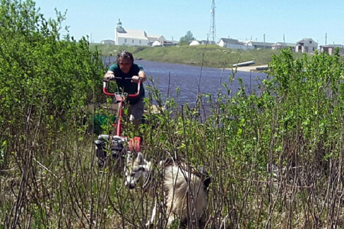 Bringing a rototiller onto Potato Island. Attawapiskat is in the background.