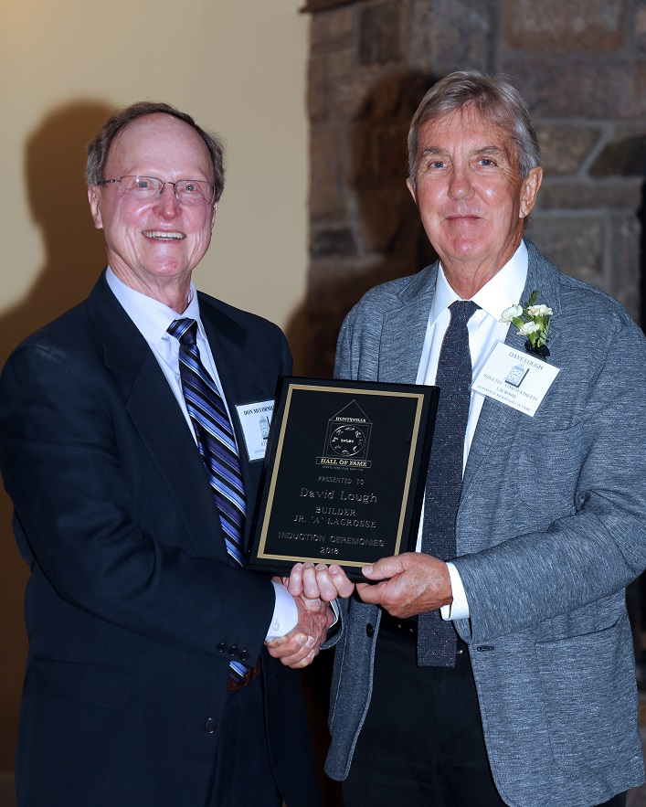 Dave Lough (right) receives his induction plaque from Hall of Famer Don McCormick