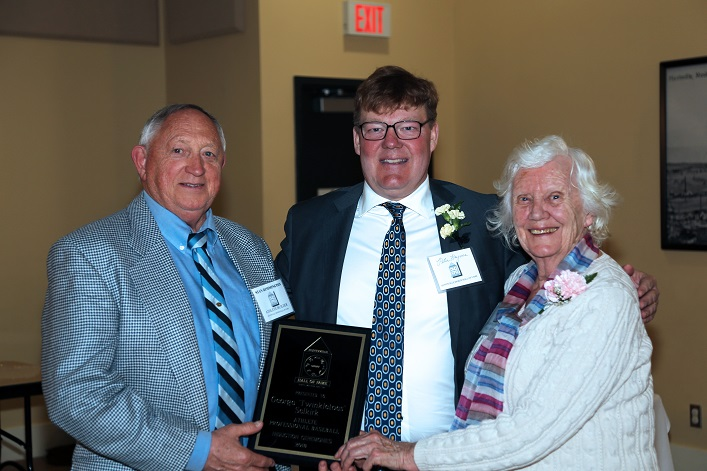 Hall of Famer Stan Rimmington (left) presents the George Selkirk plaque to Peter Haynes and Elizabeth McMillan (Selkirk's great-niece)