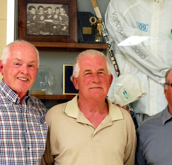 Roy MacGregor (left) with longtime friends Tim Kelly and Don Strano. They are three of the five young hockey players pictured at upper left in the display.