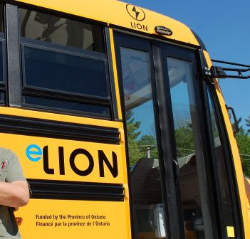 Driver Stan Latour with Campbell Bus Lines' new electric bus