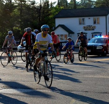 Participants in the 2018 Mayor's Bike Ride make the turn from West Road onto King WIlliam Street, accompanied by the OPP.
