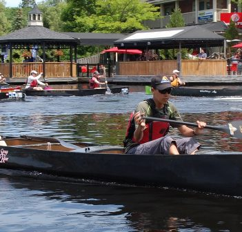 Relay team Don't Get In A Canoe With Strangers #1 (foreground) at the start of the first lap