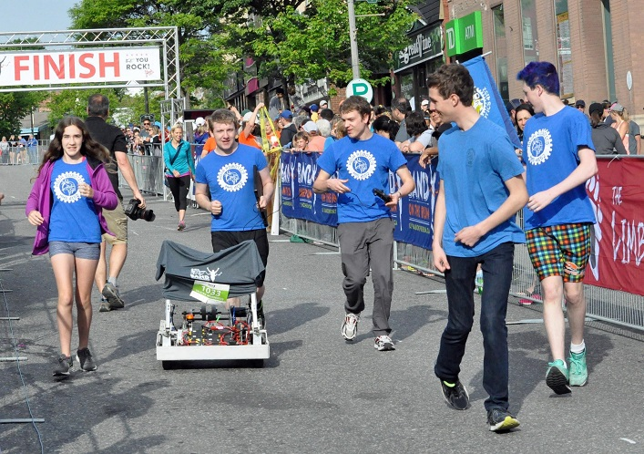 Hoya Robotics took their robot for a 'run' at the end of the kids' race