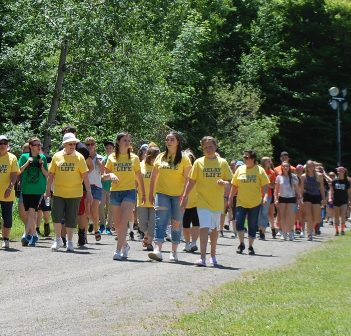 Cancer survivors lead all relay teams in the first lap of the HHS Relay for Life