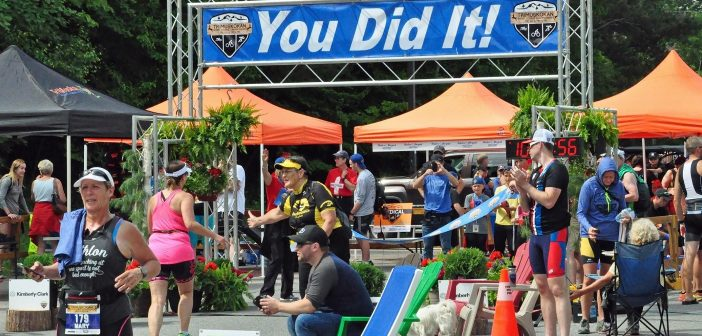 Finish line high fives at the 2018 TriMuskokan