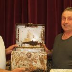 From the class of '81, teacher Tom Conlin (left) and student Bob Earl hold the time capsule that spent 37 years buried in a crawlspace in Pine Glen Public School