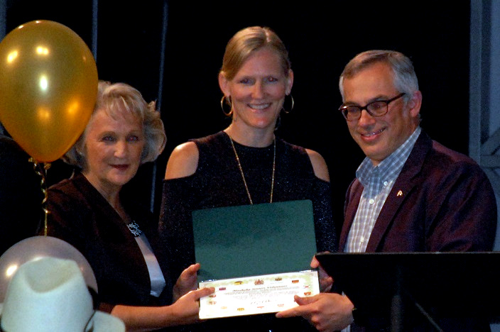 MP Tony Clement presents a certificate to Donna Nairn and Sarah Caswell