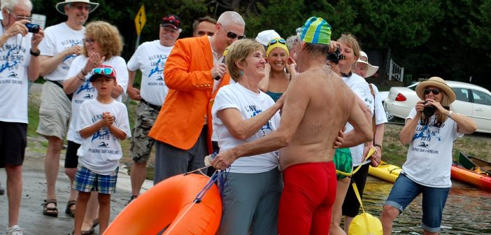 Glenn Vickery gets a hug from his wife Arlee at the end of the final stage of his swim