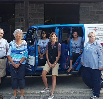 Members of the Huntsville 2019 Games Organizing Committee unveil the Games Jeep provided by Drive Muskoka