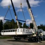 It took two cranes to lift the Tom Thomson off the truck for its launch into Mary Lake at Port Sydney (Photo: Stephenson District Lions Club/Facebook)