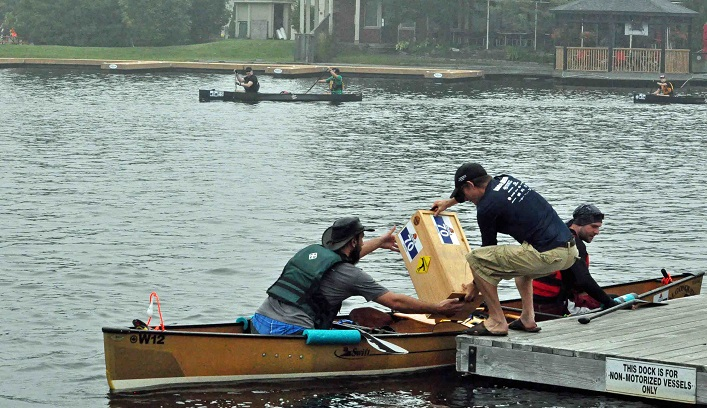 Voyageur team Paddlin' YakaChap picks up their crate from Rob Horton at the Town Dock (Photo: Cheyenne Wood)
