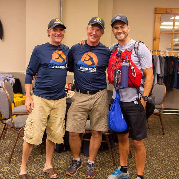 Co-organizers Rob Horton, left, and Mike Varieur, centre, with an AOMRX competitor at registration (Photo: Randy Mitson)