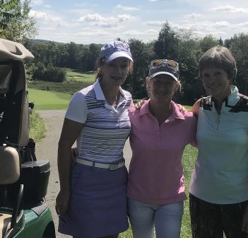 (From left) Diane Higgins, winner Debbie Court and Ginny Marshall at the 18th green at Grandview during the final round of play