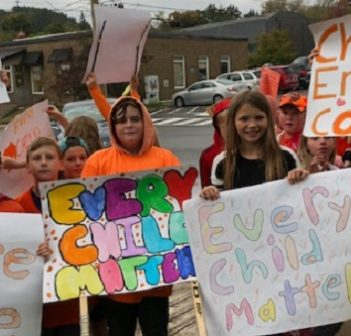 Huntsville Public School students with the signs they created for Orange Shirt Day