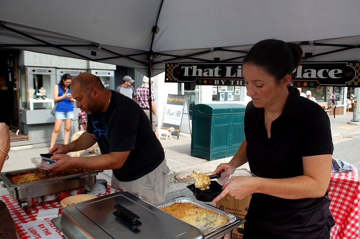 Manny (left) and Lindsay Buttus serve up Creamy Baked Pancetta and Peruvian Pepper Mac and Cheese (right) and lasagna