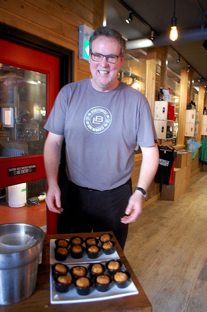 Nick is grinning because the Huntsville Brewhouse's Jalapeno Mac and Beer Cheese Croquettes (served with New England IPA jelly) are that good!