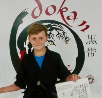 Carson Turney, 13, receives his Black Belt