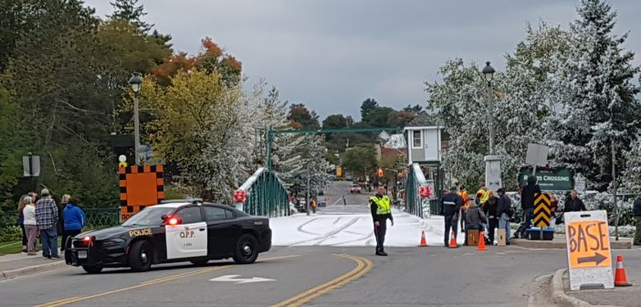 Huntsville's swing bridge is dusted in snow for the filming of a Hallmark movie.