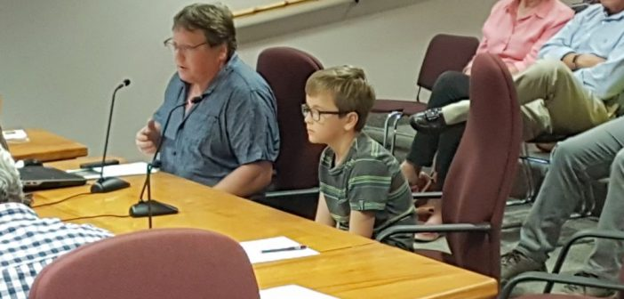 Darcy Ball and his son Riley ask planning committee to allow them to keep their chickens.