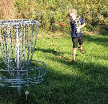 Disc golf is for all ages. Here, Bryce Farley aims for the basket (Photo: Kevin Farley)