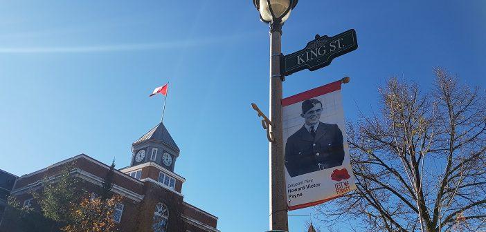 Eighteen banners hanging along Huntsville's Main Street commemorate fallen WWII soldiers