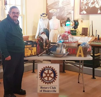 Rotarian Peter Redwood with just a few of the hundreds of items available in the annual Rotary Club of Huntsville auction