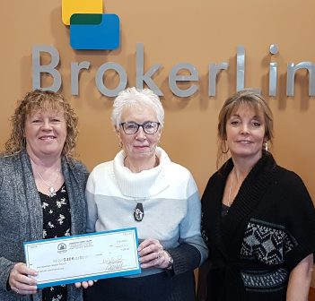 Brokerlink staff present a donation to the Canadian Cancer Society from funds raised in part at the 12th annual Breast Cancer Awareness Day BBQ