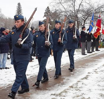 Cadets, relieved from their post after maintaining an overnight vigil, march past veterans and their families at the end of the 2018 Remembrance Day ceremony