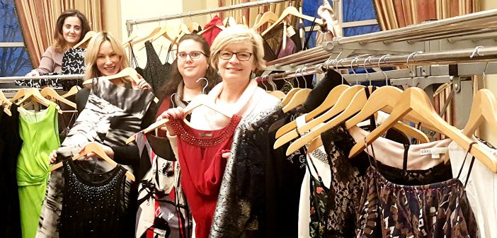 (From left) Amal Daou, Moe Kelso, Deb Hill and Laura Kennedy with some of the dresses donated during Girlfriends' Getaway Weekend