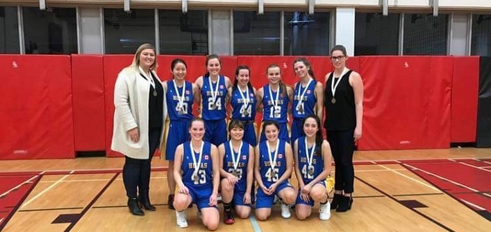 The Hoyas senior girls basketball team are 2018 MPS champions (back from left) assistant coach Jessica Bilz, Kanon Okura, Celeste Dupuis, Zoe Long, Gabby Arsenault, Taea Schmidtke, head coach Samantha Garrod; (front from left) Kaiya Roberson, Ayan Shibano, Lauren Hooey, and Anjali Jindal. Missing from photo: Megan Simson and Jenna Yeo. (supplied)