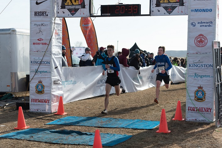 Cameron Heinz (right) crosses the finish line (Photo: Peter Stokes)