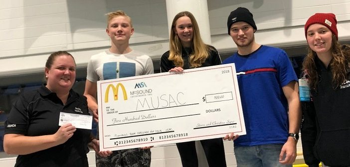 MUSAC accepts a $500 prize at a recent competition (from left) Coach Morgan Kierstead, Tyler Skinner, Dale Graham, Mark Cox and Ally Goldring (supplied)
