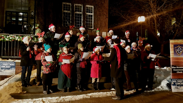 The Huntsville Community Choir sang cheery holiday carols prior to the tree-lighting on the Town Hall steps