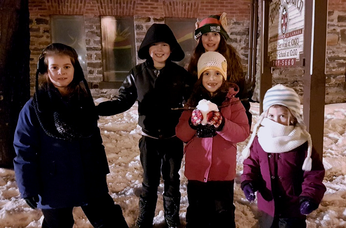 (From left) Eva Martins, Alex Striez, and Eden (in back), Mary and Grace Martins had snow much fun waiting for Santa to arrive