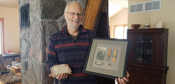 Scott Winchester with his grandfather's WWI service medals and letters home