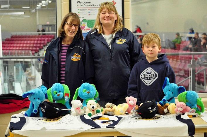 Teddy Bear Toss volunteers (from left) Pam Nadrofsky, Kelly Graham-Tanner, Ryder MacKinnon