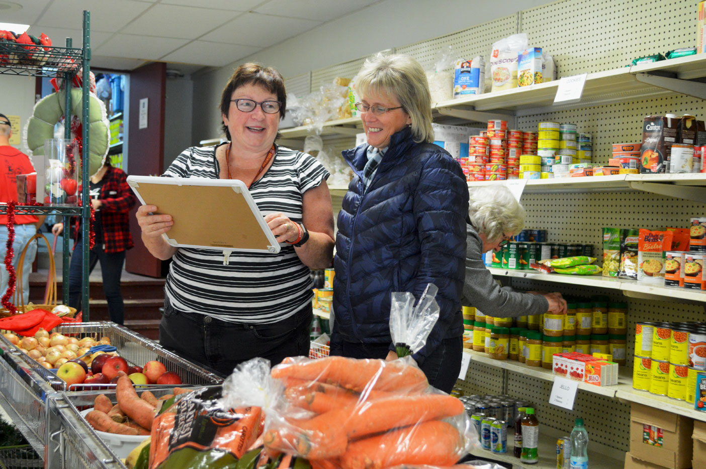 Can't you tell that Barb Stronach (left) and Elaine Super love what they do? Volunteering at the food bank gives them something to smile about. They're helping to make a difference in the lives of those who are less fortunate.