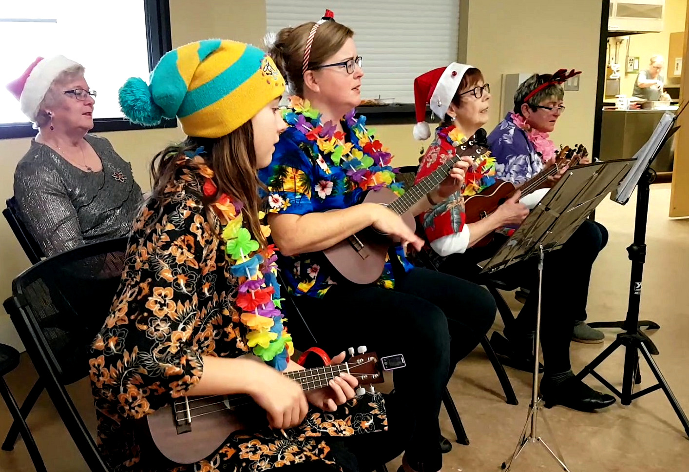 The Huntsville Ukulele Group (front from left) Mya Wilkin, Karen Ross, Mary Lou Verbonac and Sharon Stahls with singer Pauline Diamond (back left) got members of the Town of Huntsville's Diner's Club Luncheon singing along to Christmas carols at the Active Living Centre on December 5.