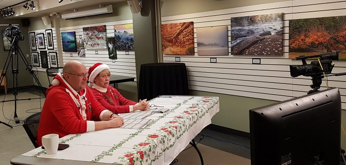 Drew Markham (left) and Mary Rashleigh were among the many Rotarians who appeared on YourTV to encourage bidders during the final hours of the 2018 Rotary auction