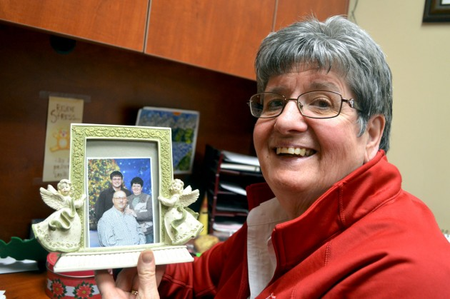 Sharon Dalrymple holds a photo of her husband Doug and son Brad. Doug, who passed away two years ago, was like the Salvation Army's own Santa Claus. He continues to be missed greatly by the organization's staff and volunteers.