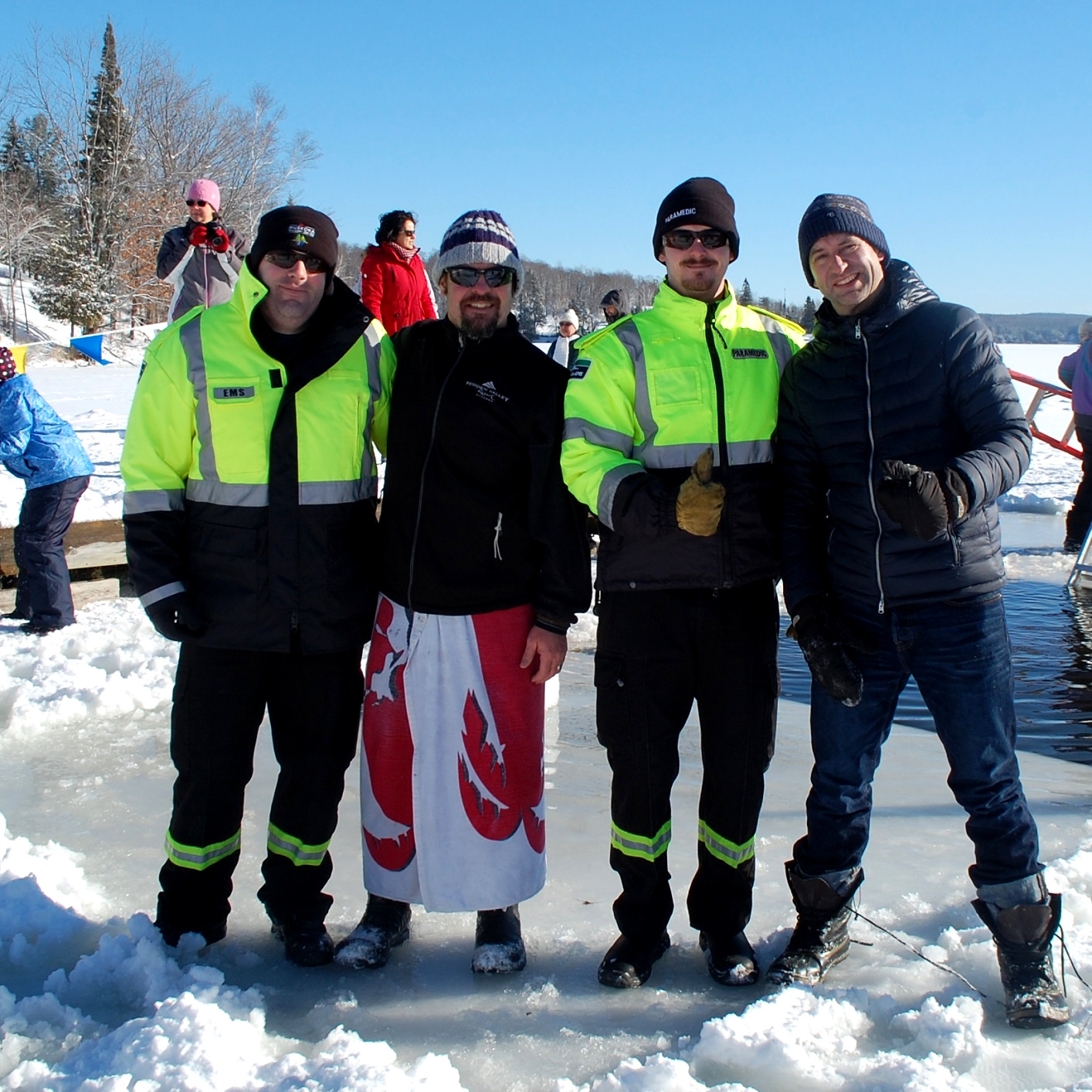 Paramedics Travis Stone (left) and Rob Patterson, with Hidden Valley Resort GM Scott Doughty (second from left) and organizer Markus Latzel, were on hand to help any dippers who needed assistance