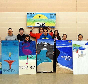 Local students proudly display the Mamma Mia! posters they created