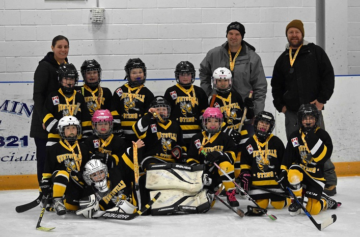The Novice Sting won gold in their home tournament (back from left) coaches Erin Torrance, Jeremiah Tilstra, Jeff Earl and Krista Earl; (middle row from left) Sophie Mann, Lauren Torrance, Tessa Easy, Lachlan Calligan, Lily Gamper; (front from left) Sydney Kerr, Mackenzie Adams, Miah Tilstra, Journey Chambers, Liliana Henderson, Molly Wolgemoth, and (in front) goalie Waverly Earl.