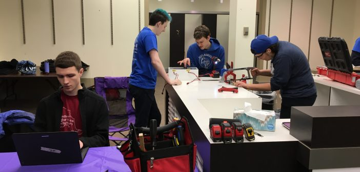 There's a lot more to robotics than driving the completed robot! Hard at work are Hoya Robotics team members (from left) Oliver Byl, Morghan Kiverago, Sam Topps, and Andrea Bonafini.