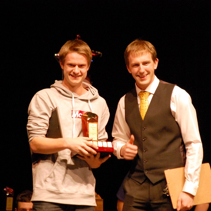 Dylan Jongers (left) accepts the Spirit of the Games award from Billy Wray
