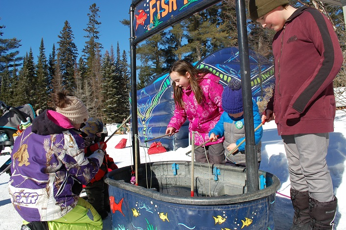 The fishing booth delighted young anglers (from left) Farrah Dukoff with Parker Cousintine, Jo-Leigh Armour, Hudson Dwyer, and Jacob Wright