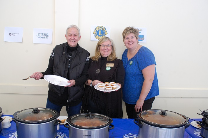 (From left) Jean Hall, Lorraine Blondin and Tanya Grainger serve up samples in the chili cook-off
