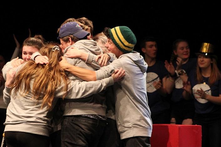 HHS Moot shares a group hug following their win (Photo: Madi Jones)