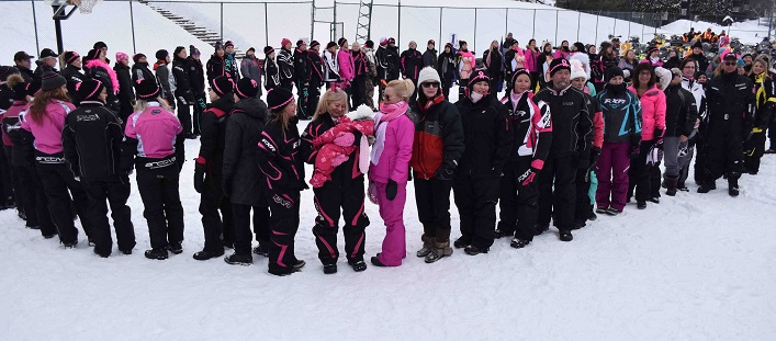 Riders line up to form the 0 in 20, representing 20 years of the Kelly Shires Breast Cancer Snow Run